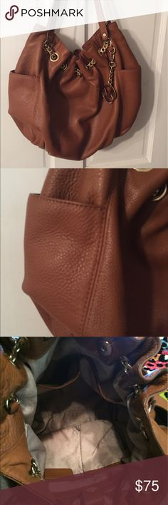 Michael kors leather handbag Brown authentic MK handbag. Excellent condition w slight discoloration on inside of bag. Clasp closure. Many pockets. Can add more pictures. Michael Kors Bags