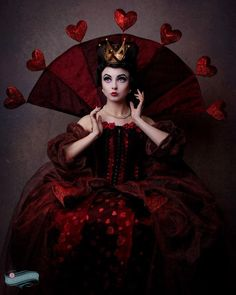 HCTO Steampunk red is dark red with plenty of black. Our Margarete and Percy costumes are primary red and gold. The stock Queen of Hearts is also primary red.  Any ideas about how to twist them to be more in line with the feel we are going for?