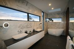 Spacious bathroom with marble look tiles & a free-standing bath by Gremmo Homes Luxury Bathroom Vanities, Bathroom Vanity Tops, Luxury Bathrooms, Bathroom Ideas, Custom Home Builders, Custom Homes, Marble Look Tile, Bath Surround, Bathroom Windows