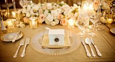Gold rimmed glass and statement cutlery.