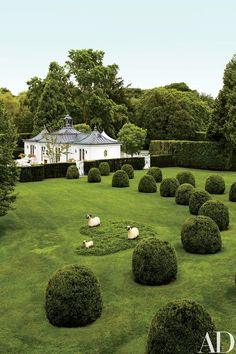 Topiary promenade by designer Charles Stick, leads to a poolhouse by architect Charles Muse; sheep sculptures by François-Xavier Lalanne | ref. archdigest.com