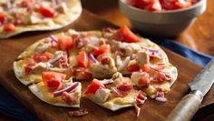 Flour tortillas make an easy flatbread pizza crust! Prebaking them for a few minutes before topping helps to keep them crisp.