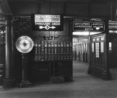 Passenger facilities beneath Liverpool Street station, London, 1956. They include the Gentlemen's toilet, hairdressing saloon and baths, and a weighing machine. There are also vending machines selling chewing gum, chocolate and confectionery. A sign directs passengers to the Metropolitan line underground station.