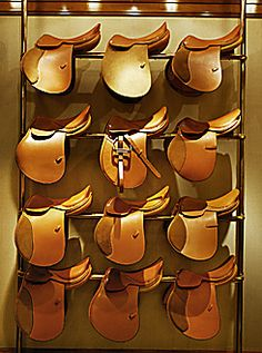 Hermes Saddles on display in the Madison Avenue flagship. I just walked by the front windows the other week and there was a lustworthy knit poncho in the front window.