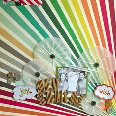 I can't tell you how much I love this Kesi'Art rainbow paper and had a hard time not hoarding it for this layout. The B side is awesome too. I used the plano stamp from Ring Toss with clear Zing then stitched on the snowflakes.