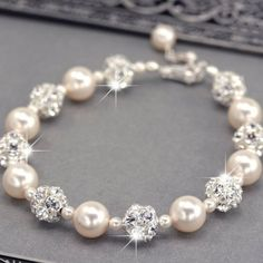 Swarovski Pearl and Rhinestone Bridal Bracelet, $57.. oh holy crap. combines my love of pearls and sparkle perfectly! pearls and Swarovski bracelet pulsera de perlas y Swarovski collar pulsera perlas swarovski joyeria necklace bracelet pearls crystal jewelry  http://iaguirreb.wix.com/deperlas#!blank-2/c1ger