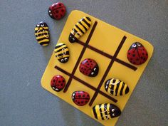 Tic-tac-toe game made from bees and ladybug painted rocks. This one was bought at a craft fair but we then made our own, first by collecting flat rocks at the beach, then painting them, and then we made a board out of felt.