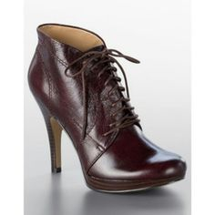 Nine West Trixxy booties Worn 2 or 3 times, I can't wear platforms :( Super cute reddish brown. Excellent condition. Nine West Shoes
