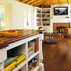 Love cabinetry, floors, wood ceiling, fireplace! So pretty