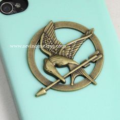 The Hunger Games Logo Mockingjay pendant light green iPhone 4/4S case, Apple iPhone 4 Case, iPhone 4s Case, iPhone 4 Hard Case --- SALE. $8.99, via Etsy. OMG i need this