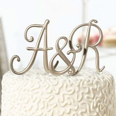 Personalize your wedding cake with a custom monogram using these beautiful 5 inch gold cake topper picks. Available in letters A through Z, as well as the ampersand, these resin, gold-plated monograms make great cake toppers for an anniversary celebration or your wedding reception. Order the bride's and groom's initials, with the ampersand included in the middle for a twist on the classic 3-letter monogram or for couples keeping their last name. See it here…