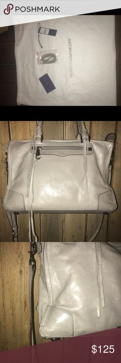 """Rebecca Minkoff Large Regan Satchel Gray Preowned very popular Regan Satchel No Smoke/pets Satchel is in over good condition.  The bottom corners and handles show alittle wear but it does not take away from attractiveness Rebecca Minkoff pebbled leather satchel bag with silvertone hardware.  Includes dustbag and unused tassel  Rolled whipstitch top handles, 4.5"""" drop. Exterior, front zip pocket with studs at ends. Interior, jacquard lining; three card slots. One zip pocket. Approx. 9""""H x…"""