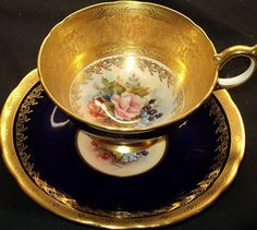 Elegant gold and black teacup, perfect for a theme of vintage elegance.