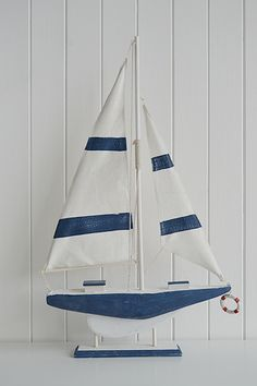 Tall decorative wooden boat in white and blue