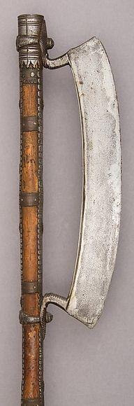 Indian (Chota Nagpur) axe, 19th century, steel, wood, iron, brass, L. 53 3/4 in. (136.5 cm); L. of head 13 3/4 in. (34.9 cm); W. 4 5/8 in. (11.7 cm); Wt. 2 lbs. 7 oz. (1105.6 g), Bequest of George C. Stone, 1935, Met Museum.