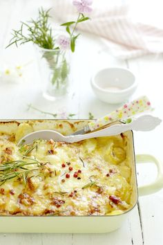French recipe for baked potatoes with cheese. The recipe is in French but the photos throughout the recipe are beautiful.  I can translate with Bing.