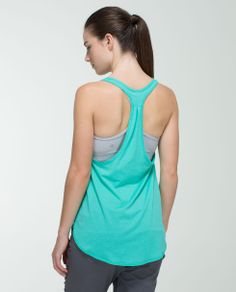 We designed this lightweight and loose-fitting tank to layer easily over any bra. The breathable, wicking and anti-stink fabric helps to keep us cool in even the hottest of Hot yoga classes so we can go ahead and get sweaty.
