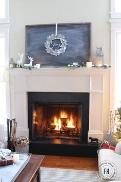 Traditional Christmas Mantel with chalkboard and DIY Galvanized leaf wreath.