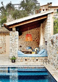 Deià Mallorca The fabrics for the patio are from Tapicería Riera, the lamp (from a Balinese chicken Deia Mallorca, Stone Houses, Outdoor Areas, Pool Houses, Pool Designs, Exterior Design, Exterior Colors, Exterior Paint, Beautiful Homes