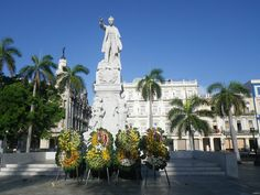 The classic Hotel Inglaterra in old Havana is opposite a leafy square presided over by a statue of national hero Jose Marti. The floral tributes mark the anniversary of his death.