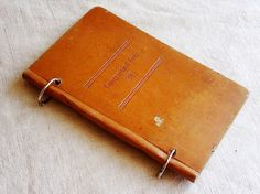 vintage loose leaf binder made from an old leather book cover. Available at AtticAntics, $12.00