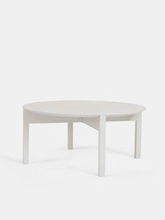 """BEISTELLTISCH CELINDE HOCH by Lukas Klingsbichel – """"Celinde"""" is a set of three cylindrical coffee tables made out of European ash wood. The set can accompany single lounge chairs as well as it is able to structure larger seating areas. The flat round top can be used as a tray which gently slides in place, guided and held by its sloped edges. The feet construction can be assembled with only one anodized aluminum screw. They come in many different PU lacquer colors. Seating Areas, Round Top, Lounge Chairs, Coffee Tables, Ash, Larger, Tray, Construction, Colors"""