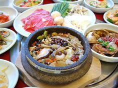 영양돌솥밥(yeongyang-dolsotbap) / Nutritious Stone Pot Rice  Rice, ginseng, chestnut, and jujubes, cooked and served in a hot stone pot. It comes with a soy sauce.