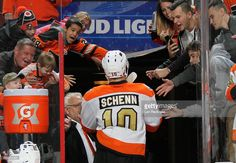 Brayden Schenn #10 of the Philadelphia Flyers leaves the ice surface and greets his fans after scoring a hat trick during a 4-2 defeat of the Dallas Stars on December 10, 2016 at the Wells Fargo Center in Philadelphia, Pennsylvania.