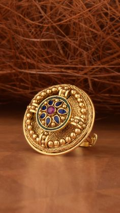 Sculptural gold ring studded with bold hues. Gold Wedding Jewelry, Gold Jewelry Simple, Gold Rings Jewelry, Jewelry Design Earrings, Gold Ring Designs, Gold Bangles Design, Gold Jewellery Design, Gold Jhumka Earrings, Gold Mangalsutra Designs