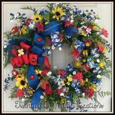 Texas Wildflower/Springtime floral wreath on a grapevine base by Twentycoats Wreath Creations (2017)