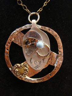 Beautiful mixed metal OOAK necklace that is by RockledgeStudios
