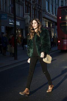 Black skinny pants, western boots, green faux fur