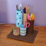 I have a quick back to school recycling project for you today. We are going to turn some cardboard tubes into a fun desk caddy, all decked out in stripes and polka dots, perfect for the preteen or teen homework desk! This is an easy project, so I'm sparing you the step by step photos. You don't