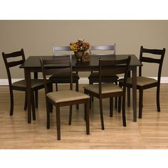 Revamp your kitchen decor with this 7-piece dining room set from Warehouse of Tiffany. This set includes six gorgeous chairs and an oak wood table.