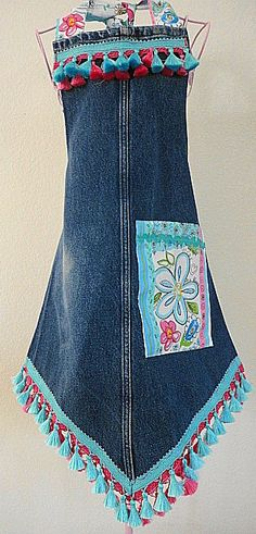 Cute apron made from leg of some jeans... Less all the frilly embellishments.  I like the point.   ~t~