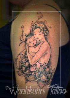 Mothers embrace. Mom and baby tattoo.