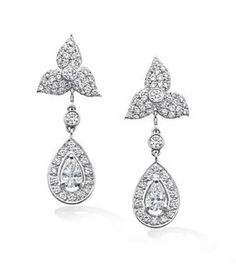 """""""Robinson Pelham have also designed and made a pair of diamond earrings for Miss Philippa Middleton. These earrings are more floral in nature to compliment the headpiece worn by Miss Philippa Middleton during the Service."""" - officialroyalwedding2011.org"""