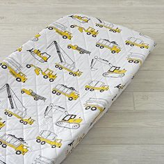 The Land of Nod's construction crib bedding is ready to lay the foundation for a good night's sleep. That's because the quilt is adorned with some of kids' favorite big machines, including bulldozers, cranes and more. And the fitted sheet and changing pad cover features white base with all over construction equipment print.