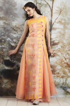 Take your dressing style to a new level of sophistication with this classy peach salwar suit. Buy Salwar Suits online - http://www.aishwaryadesignstudio.com/soft-peach-suit-in-floral-printed-overcoat