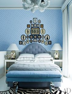 Victorian-era silhouettes mimic the shape of the headboard and are arranged on custom-colored Jonathan Adler bamboo wallpaper in a guest room. New York apartment with interiors by Pamplemousse. Next Bedroom, Blue Bedroom, Bedroom Wall, Bedroom Decor, Master Bedroom, Bed Room, Velvet Bedroom, Blue Rooms, White Rooms