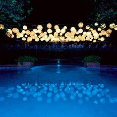 Paper lanterns strung over the pool. Love the reflection