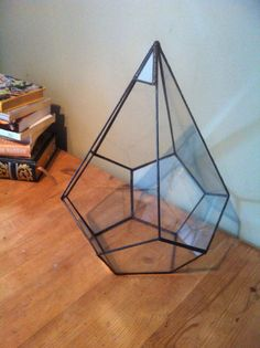 This large geometric glass terrarium makes a beautiful indoor garden or a patio decoration filled with candles for those late summer nights .