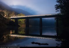 Eastbound train passes over the Potomac river,  Paw Paw, West Virginia