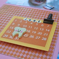 Brenda Johnston used a mini calendar and embellishment to mark a special occasion #scrapbooking