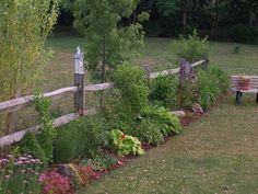 Split rail fencing with gardens | Split Rail Fence Garden. Would be beautiful by the road in the front ...