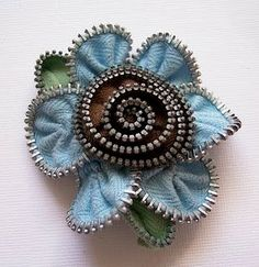 zipper flower (post has nothing to do w/ how to make these - I just pinned it bc I  thought it was cute!)