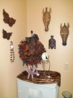Our new restroom display is based around a safari theme, complete with tribal masks, elephants and giraffes!... (Treasure Cove Mall, July 2014 Restroom Display.)