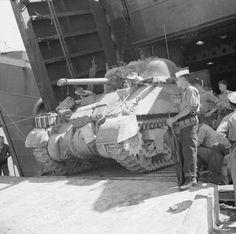 A Sherman tank of 40th Royal Tank Regiment reversing into a landing ship at Bizerta, 4-9 September 1943.