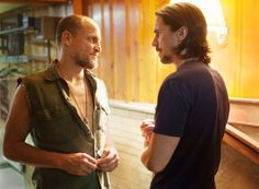 Still of Christian Bale and Woody Harrelson in Out of the Furnace. 2012.