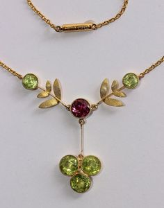 Suffrage necklace - Gold, peridot, and pink tourmaline (the twin to my inherited set w earrings + necklace - quite a surprise to find it here! Edwardian Jewelry, Vintage Jewellery, Antique Jewelry, Tourmaline Necklace, Pink Tourmaline, Suffragette Jewellery, Jewelry Ideas, Jewelry Design, Suffrage Movement